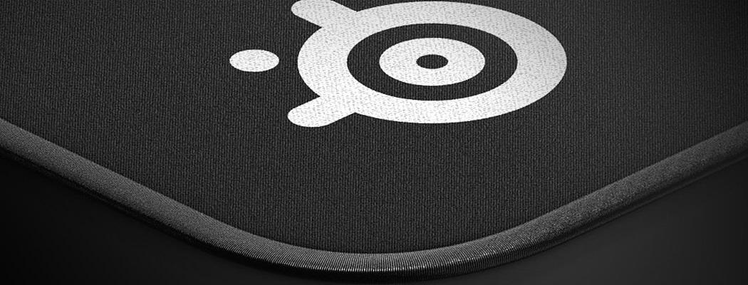 уголок коврика с эмблемой